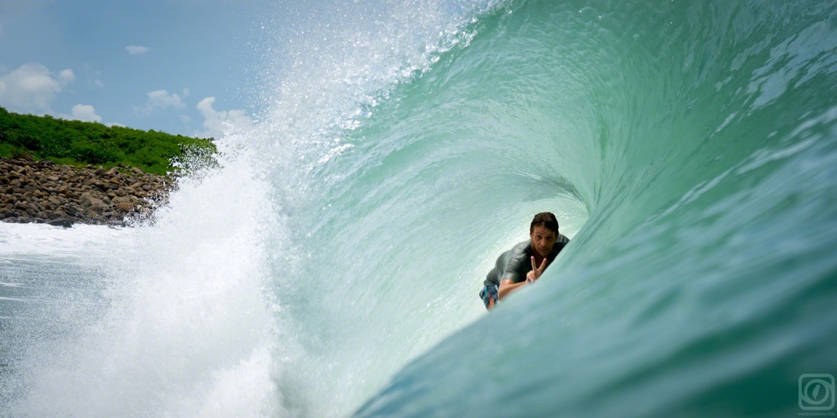 surfer in wave barrel | Surf Travel Taiwan